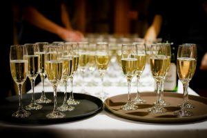 Champagne glasses on trays, ready to be served.