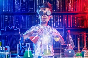 A charred mad scientist mixing substances at a chemistry bench.