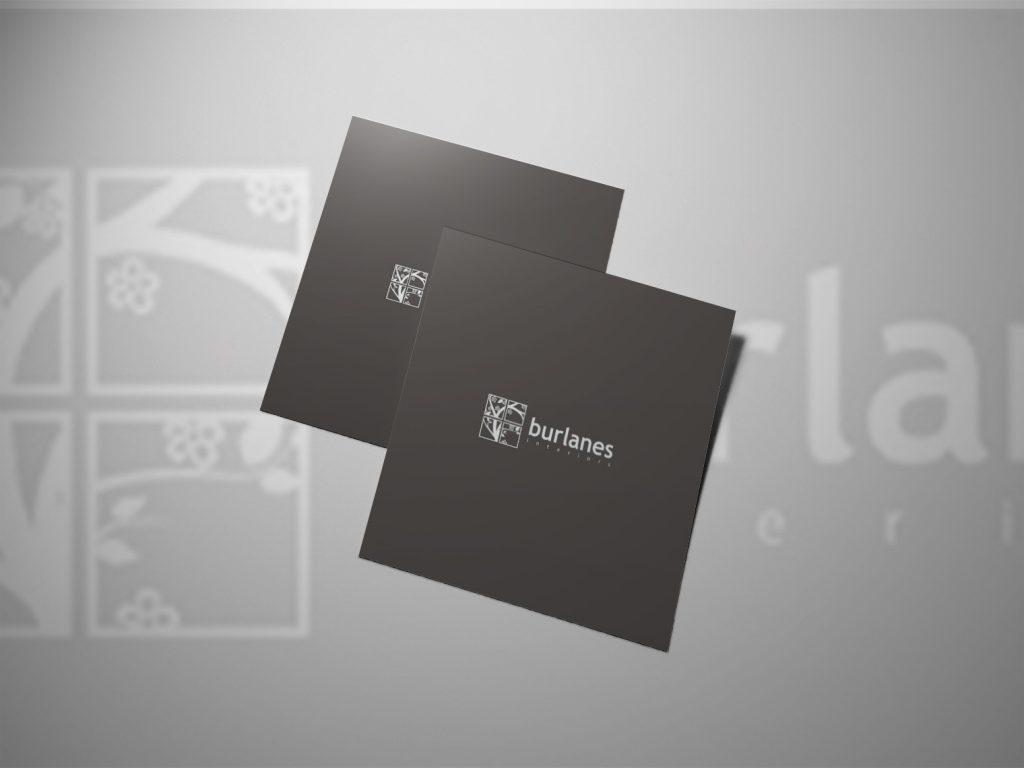 An image of two black pieces of paper with both of them showing the burlanes logo.