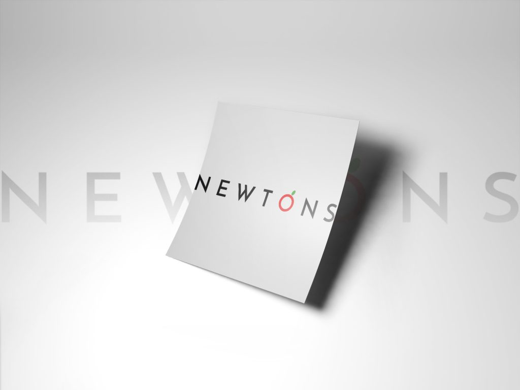 The word 'Newtons' on a white sheet of paper, against a light background.