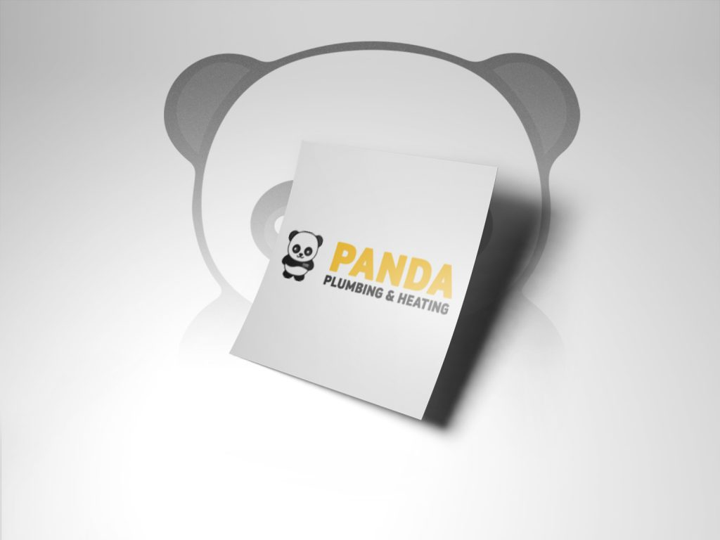 An image of a white piece of paper with the panda plumbing and heating logo in the middle. This is held up by the background which is a panda in the background, faded.