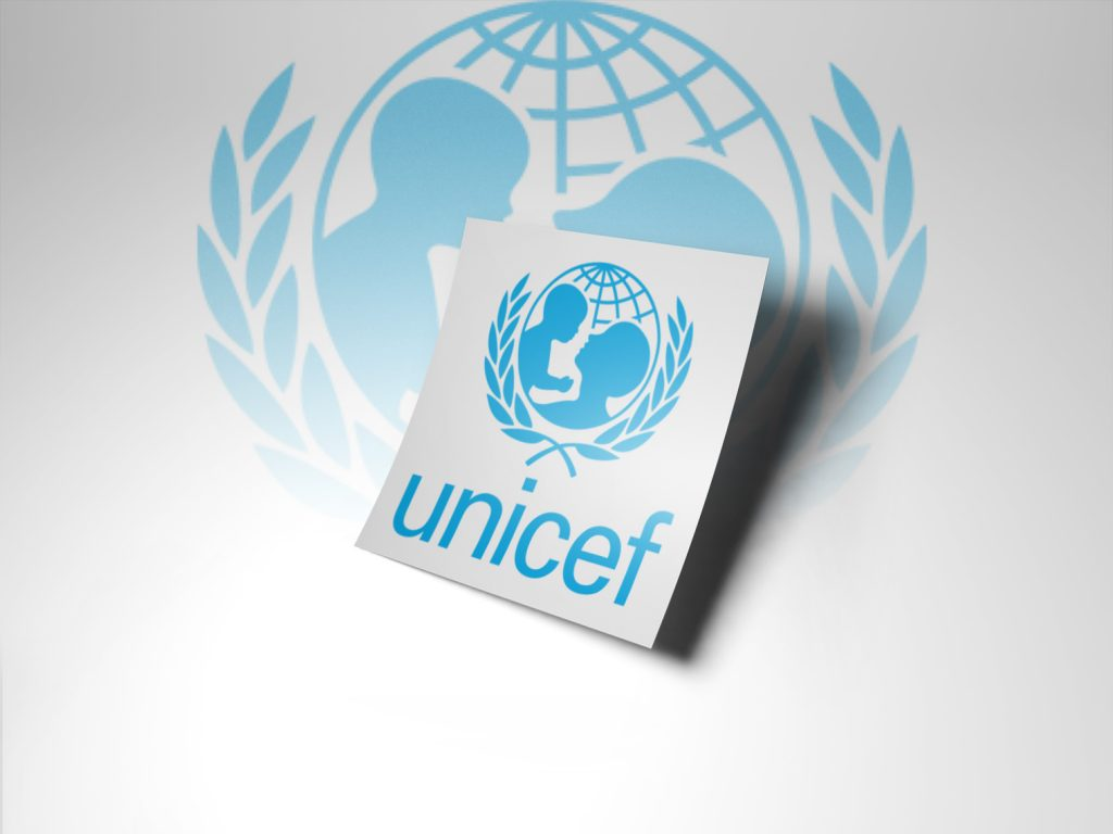 a white piece of paper with the Unicef logo being displayed