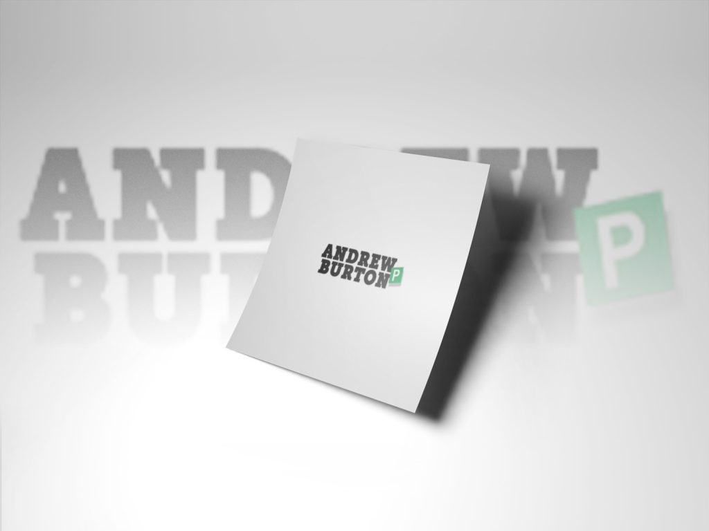 Andrew Burton Logo on a white piece of paper. This is the same logo, shadowed and faded into the background. THe logo is ijn black text in block capitals 'Andrew Burton' with a green pass plate.