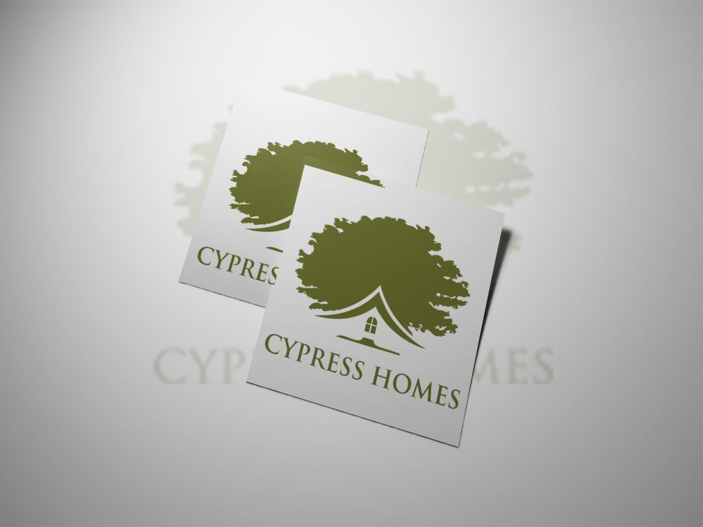 An image of two pieces of white paper with the green cypress homes logo on both pieces of paper