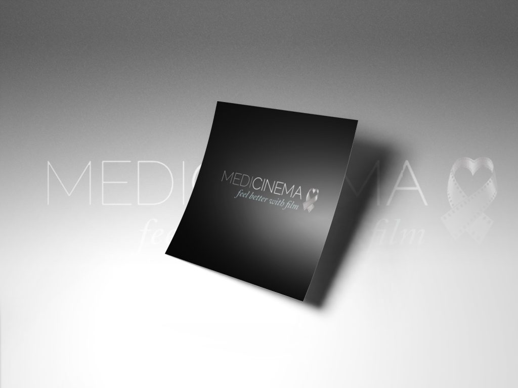 An image of a black piece of paper with medicinema logo being displayed.