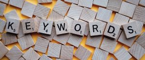 Scrabble tiles spelling out the word 'Keywords' on a background of blank scrabble tiles.