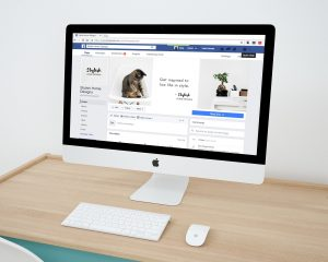A Facebook business page displayed on a desktop monitor