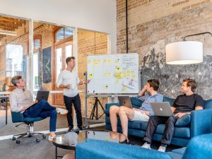 group of young entrepreneurs brainstorming in a modern office setting